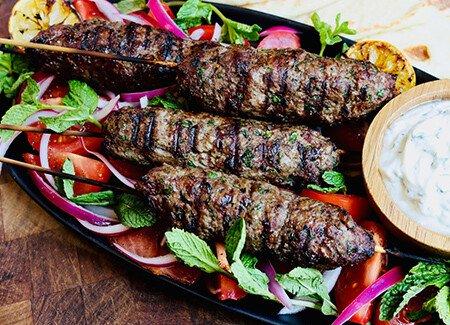 Grilled Beef Koftas with Herbed Lemon Yogurt & Pickled Onions