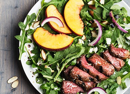 Grilled Grass-Fed Strip Steak Salad with Peaches