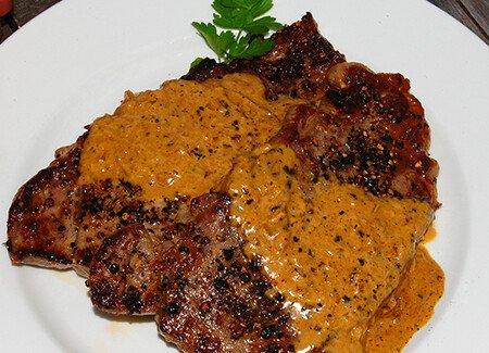 NY Strip Steak with Black Peppercorns & Bourbon Cream Sauce