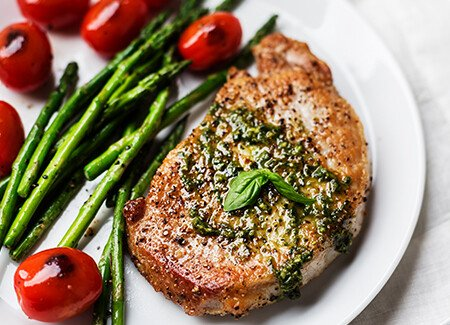 Pesto Pork Chops with Asparagus and Tomatoes