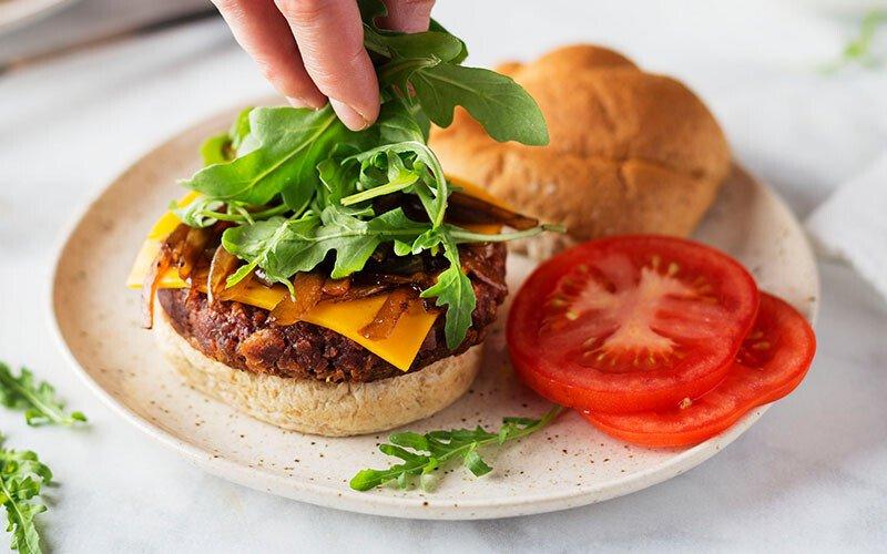 Plant-Based Arugula and Caramelized Onion Burger